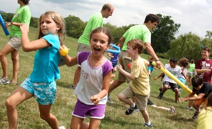 Kids and Counselors with Water Balloons